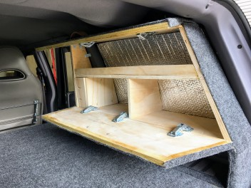 We blocked off one side of the rear windows since we never use it and made a small easy access storage.